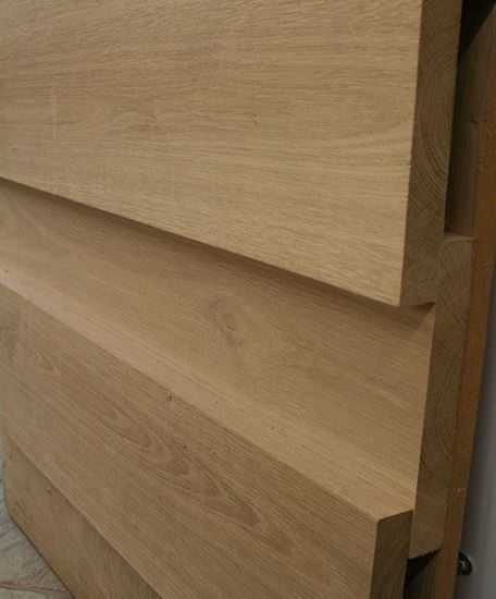 Board on Board cladding in Oak. Available in a variety of widths from Venables Brothers Ltd.